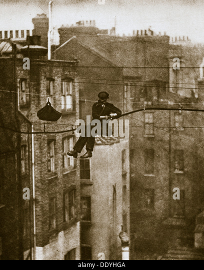 Inspecting a telephone cable between Conduit and Maddox Streets, 20th century. Artist: Unknown - Stock Image