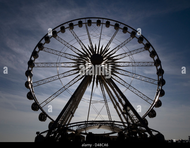 Brighton wheel silhouetted by the sunshine at Brighton, East Sussex, UK - Stock Image