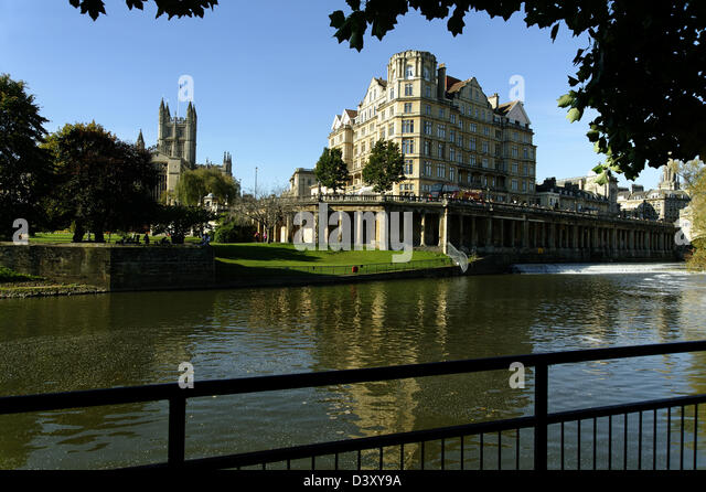 River Avon, Bath, with the Empire Hotel and Bath Abbey in view - Stock Image