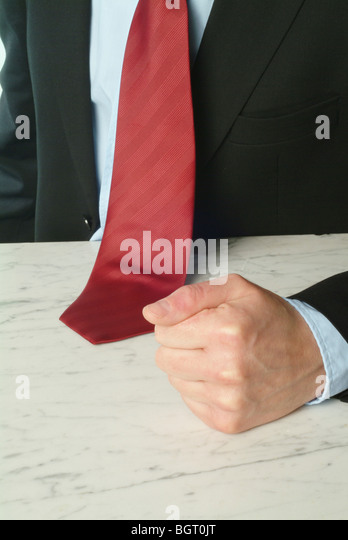 Man banging his fist on a table - Stock Image