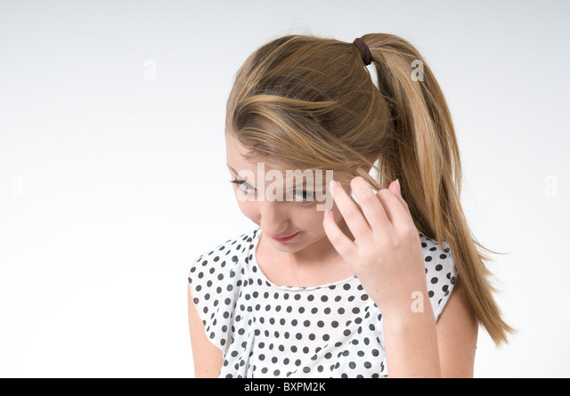 Timid teen On white Background - Stock Image