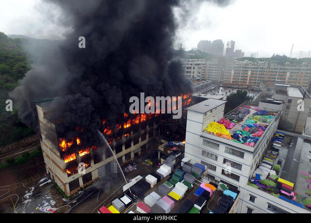 Quanzhou. 26th Nov, 2016. Photo taken on Nov. 26, 2016 shows the factory that caught fire in Quanzhou, southeast - Stock Image