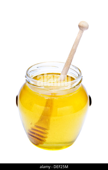 glass of honey isolated on a white background - Stock Image