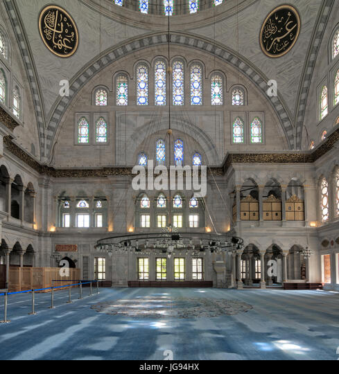 Interior of Nuruosmaniye Mosque, an Ottoman Baroque style mosque built in 1755, with a huge arches & many colored - Stock Image