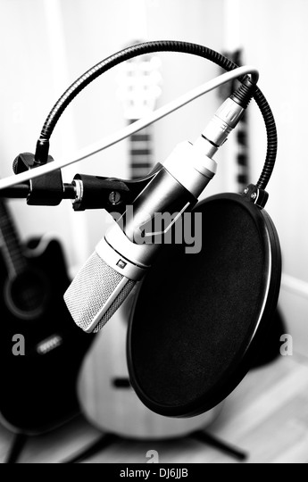 microphone and guitars in music studio - Stock Image