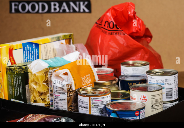 Box of essential food items ready to be handed out. - Stock Image