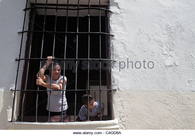 Santo Domingo Dominican Republic Ciudad Colonia Calle Jose Reyes neighborhood residential street home wrought iron - Stock Image