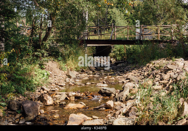 how to build a wooden bridge over a creek