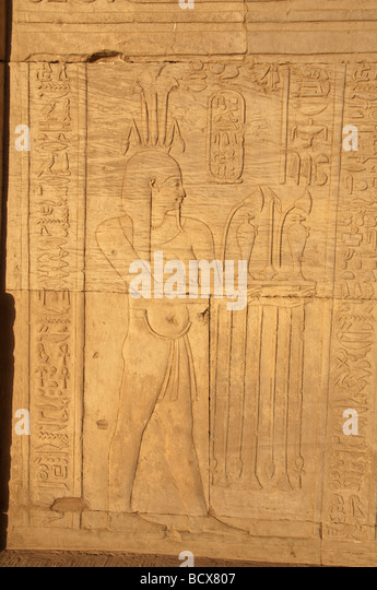 Egypt Kom Ombo temple hieroglyph carving relief pharaoh wearing crown - Stock Image
