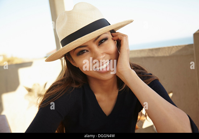 Portrait of young woman in hat, Palos Verdes, California, USA - Stock Image