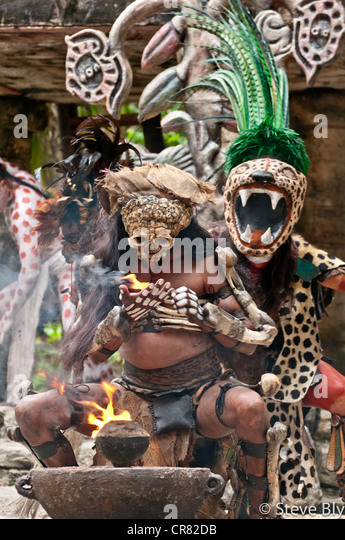 A Maya fokllore fire dance ritual is performed by mystical performers in Xcaret Show, Riviera Maya, Quintana Roo, - Stock Image