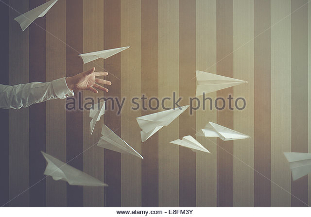 Person'S Hand Throwing Paper Aeroplanes - Stock Image