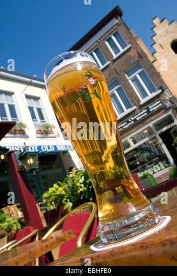 A cold glass og the local beer called Brugse Zot, during a sunny day, city trip bruges (brugge), Belgium - Stock Image
