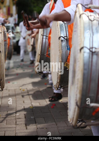 An abstract view of drummers hitting the traditional drum called the DHOL during a traditional Ganesh festival procession - Stock-Bilder