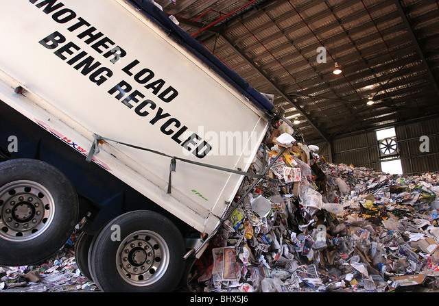 Truck unloading recycling - Stock Image