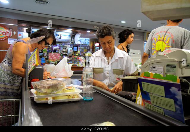Argentina Mendoza Villa Nueva Mendoza Plaza Shopping grocery store supermarket business shopping checkout line counter - Stock Image