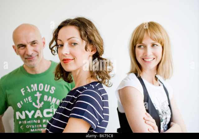 3 business people in happy mood - Stock Image