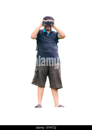 A young boy watching through binoculars with copy space and isolated on white showing hobby related scientific activity - Stock Image