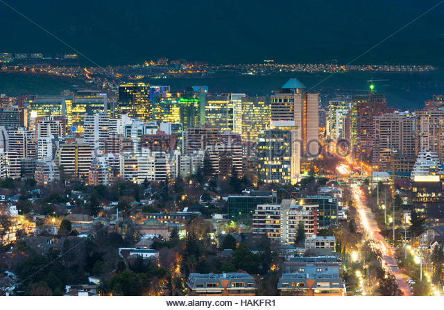 View of residential, office buildings and hotels at night in the wealthy district of Las Condes in Santiago de Chile - Stock Image