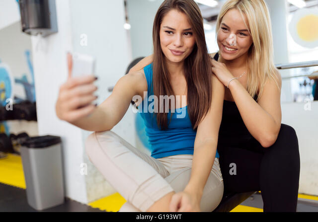 Beautiful  women taking selfies - Stock Image