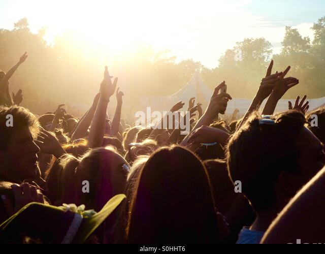 Image of hands in the air at Citadel Festival 2015 with sunlight behind. - Stock-Bilder
