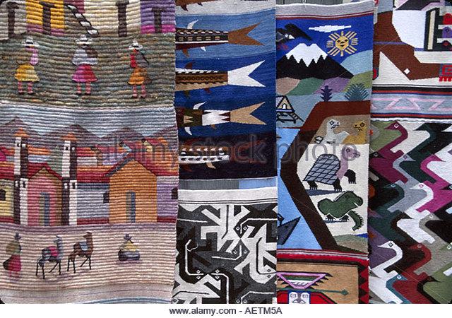 Ecuador Saquisili Market Otavalo Cotopaxi Chibuleos Indigenous natives blankets arts and crafts for sale fabrics - Stock Image
