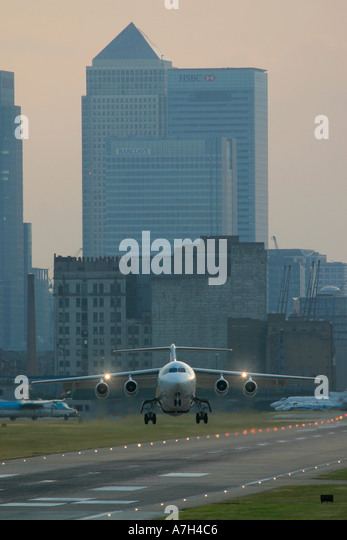 Air France British Aerospace BAe 146 200 taking off with strong crosswind at London City Airport UK - Stock Image