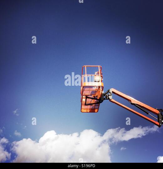 A crane and clouds. - Stock Image