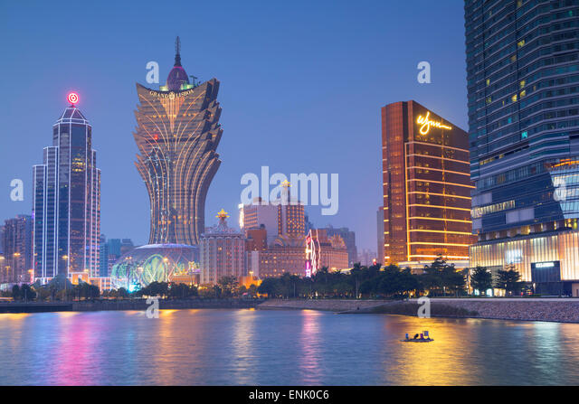 Grand Lisboa and Wynn Hotel and Casino at dusk, Macau, China, Asia - Stock Image