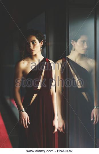 Elegant young woman in a red dress - Stock-Bilder