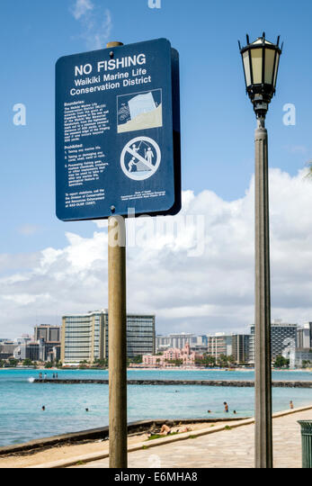 Hawaii Hawaiian Honolulu Waikiki Beach Sans Souci State Recreational Park Pacific Ocean sign Marine Life Conservation - Stock Image