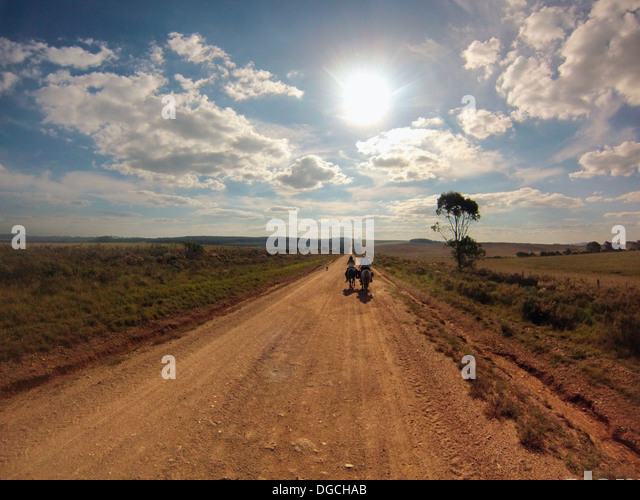 Senior man riding horse on dirt track, Uruguay - Stock Image