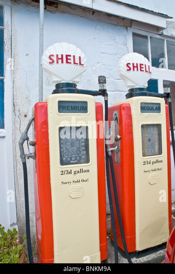 Old petrol pumps and AA sign  at St Mawes Cornwall England - Stock Image
