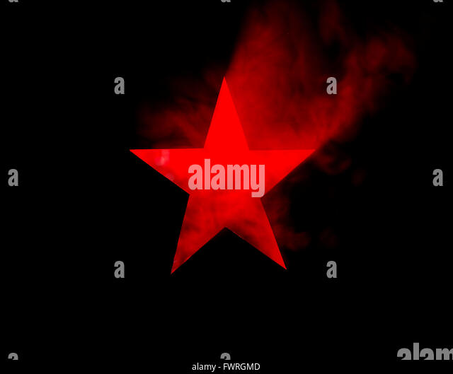 Red Star. Hole cut in cardboard, smoke machine and spotlight. The image may appear noisy, but that is the texture - Stock Image