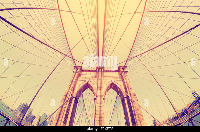 Vintage filtered fisheye picture of Brooklyn Bridge in New York City, USA. - Stock Image