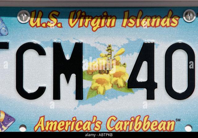 St. Thomas USVI Charlotte Amalie vehicle license plate yellow Ginger Thomas flower America's Caribbean - Stock Image