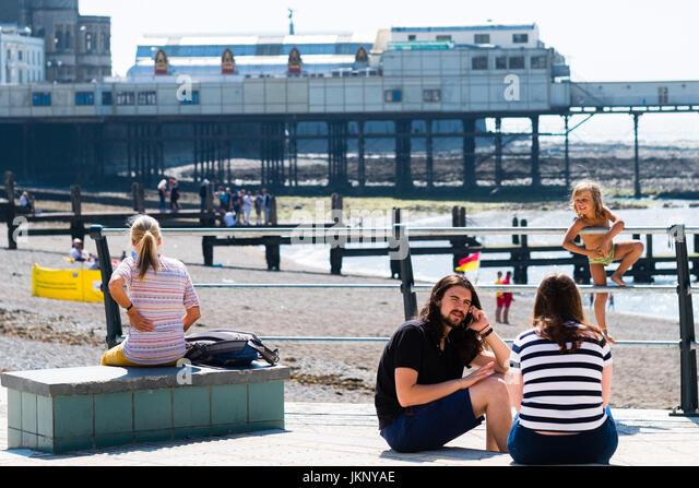 Aberystwyth Wales UK, Monday 24 July 2017 UK Weather: people enjoying an afternoon of bright warm sunshine at the - Stock Image
