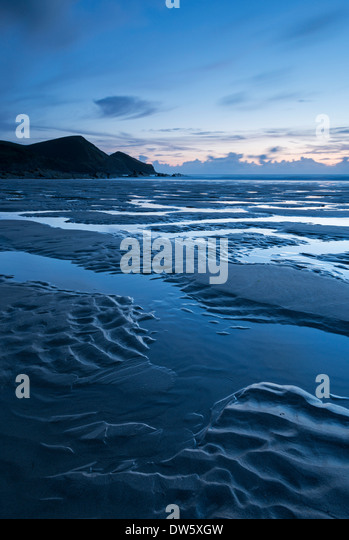 Low tide on Crackington Haven Beach during twilight, Cornwall, England. Summer (August) 2013. - Stock Image
