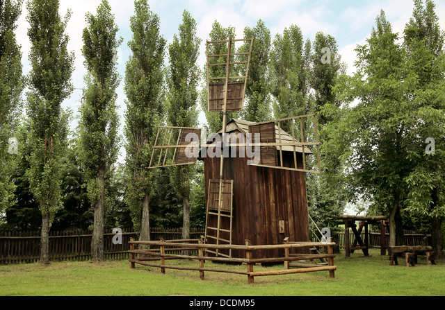 Photo of an old wooden wind-mill - Stock Image