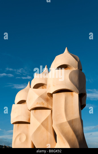 Chimneys on roof of Casa Mila by Antoni Gaudi, Barcelona, Spain - Stock Image