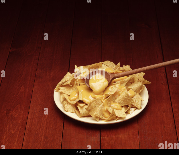 preparing cheese nachos - Stock Image