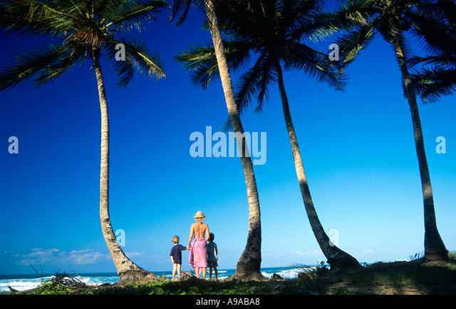 woman and two children Sol de Plata Beach Dominican Republic Hispaniola Caribbean Luke Hanna Oscar Hanna Paula Leaver - Stock-Bilder