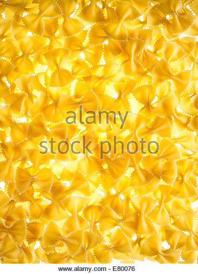 farfalle or bowtie raw pasta on a white background - Stock Image