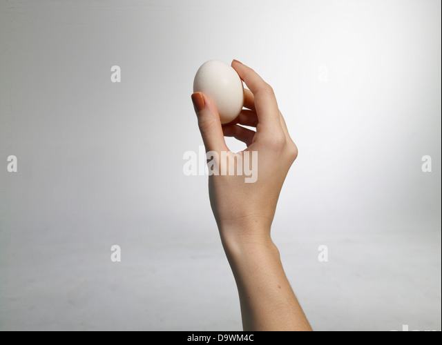 lady throwing an egg - Stock Image