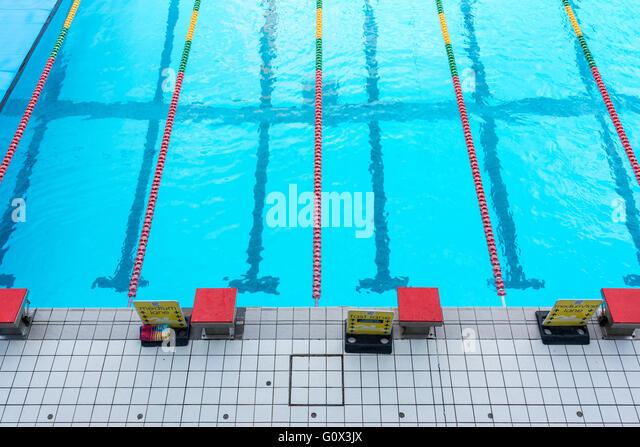 Swimming pool starter blocks - Stock-Bilder