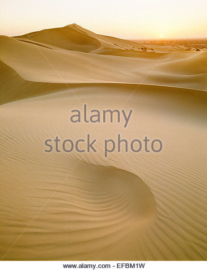 Sun setting over sand dunes in the Pinacate Reserve.  Sonora, Mexico. - Stock Image