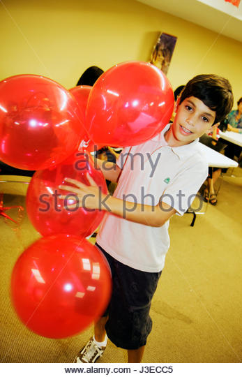 Miami Florida Miami Art Central Festival Mexico Hispanic boy play balloons heritage celebration - Stock Image