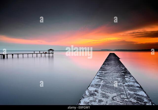 Malaysia, Negeri Sembilan, Teluk Kemang, View of jetty and sea at sunset - Stock Image