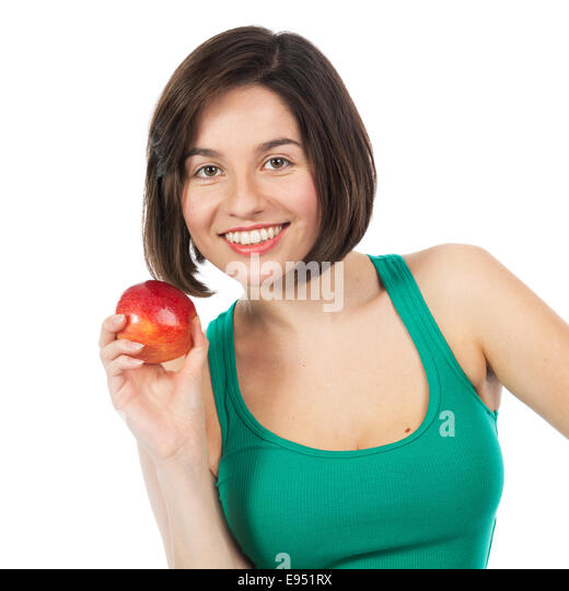 Beautiful young brunette holding a red apple, isolated on white - Stock Image