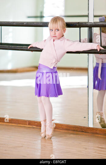 South Africa, Gauteng province, Tshwane, Pretoria, Young girl in ballet class leaning against railing - Stock Image